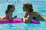 Mother and Daughter on Air Mattress in Pool    Stock Photo - Premium Rights-Managed, Artist: Harald Vorsteher, Code: 700-02645917