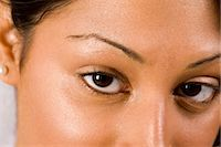 Close-up portrait of young Indian woman's eyes, looking at camera    Stock Photo - Premium Rights-Managednull, Code: 842-02649095