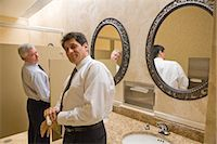Two multi-ethnic businessmen standing in office bathroom, smiling    Stock Photo - Premium Rights-Managednull, Code: 842-02650590