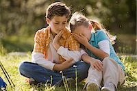 Boy and girl sitting in park, girl leaning on boy's shoulder    Stock Photo - Premium Rights-Managednull, Code: 842-02651886
