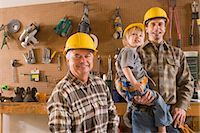 Portrait of multi-generation family of men in garage with hard hats    Stock Photo - Premium Rights-Managednull, Code: 842-02651995