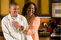 Portrait of African American mother and son standing in kitchen laughing    Stock Photo - Premium Rights-Managednull, Code: 842-02653493
