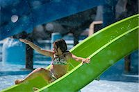 Girl sliding down waterslide at water park    Stock Photo - Premium Rights-Managednull, Code: 842-02653773