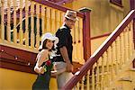 Romantic couple climbing outdoor stairs holding hands    Stock Photo - Premium Rights-Managed, Artist: Kablonk! RM, Code: 842-02654033