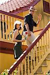 Romantic couple climbing outdoor stairs holding hands    Stock Photo - Premium Rights-Managed, Artist: Kablonk! RM, Code: 842-02654034