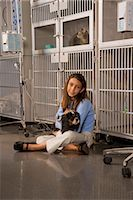 preteen  smile  one  alone - Girl comforting pet dog in veterinary clinic    Stock Photo - Premium Rights-Managednull, Code: 842-02654495