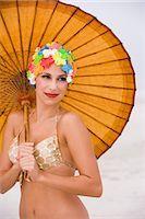 Young woman in retro swim cap holding umbrella on beach    Stock Photo - Premium Rights-Managednull, Code: 842-02655289