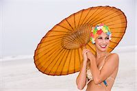 Young woman in retro swim cap holding umbrella on beach    Stock Photo - Premium Rights-Managednull, Code: 842-02655290