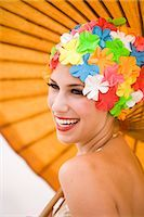 Portrait of young woman wearing retro swimming cap holding parasol    Stock Photo - Premium Rights-Managednull, Code: 842-02655304
