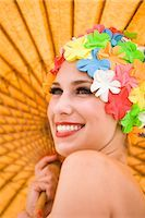 Portrait of young woman wearing retro swimming cap holding parasol    Stock Photo - Premium Rights-Managednull, Code: 842-02655305