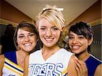 Three High School cheer leaders.
