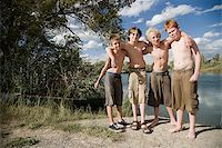pre-teen boy models - four boys playing by a lake. Stock Photo - Premium Royalty-Freenull, Code: 640-02657481