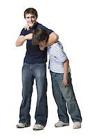 two brothers wrestling. Stock Photo - Premium Royalty-Freenull, Code: 640-02657538