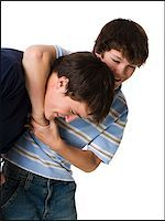two brothers wrestling. Stock Photo - Premium Royalty-Freenull, Code: 640-02657551