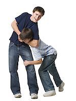 two brothers wrestling. Stock Photo - Premium Royalty-Freenull, Code: 640-02657552