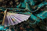 Detail of fan on top of jade green Chinese silk fabric Stock Photo - Premium Royalty-Free, Artist: AWL Images, Code: 656-02660277