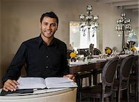 planner - Portrait of a male host to a restaurant Stock Photo - Premium Royalty-Freenull, Code: 649-02665437