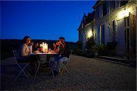 Friends having dinner outside Stock Photo - Premium Royalty-Freenull, Code: 649-02666441