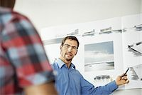 Architects working on a project Stock Photo - Premium Royalty-Freenull, Code: 649-02666896