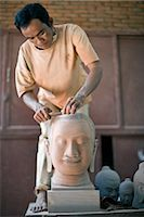 Man Carving Buddha Head Sculpture, Siem Reap, Cambodia Stock Photo - Premium Rights-Managednull, Code: 700-02670069