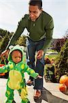 Toddler Trick-or-Treating with Father    Stock Photo - Premium Rights-Managed, Artist: SimplyMui, Code: 700-02670117