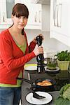 Woman Frying Salmon in Kitchen    Stock Photo - Premium Rights-Managed, Artist: Klick, Code: 700-02670208