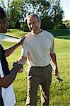 Friends Shaking Hands on Golf Course, Burlington, Ontario, Canada