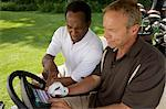 Golfers in Golf Cart with Scorecard, Burlington, Ontario, Canada