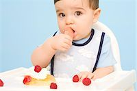 Baby Chewing on Toy in High Chair    Stock Photo - Premium Rights-Managed, Artist: Laura Johansen, Code: 700-02670489
