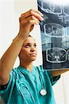 Doctor Examining X-rays    Stock Photo - Premium Rights-Managed, Artist: Artiga Photo, Code: 700-02670503