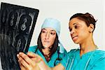 Doctors Examining X-rays    Stock Photo - Premium Rights-Managed, Artist: Artiga Photo, Code: 700-02670505