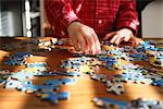 Child Playing With a Puzzle    Stock Photo - Premium Rights-Managed, Artist: Mark Peter Drolet, Code: 700-02670920