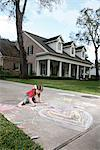 Girl Drawing on a Driveway    Stock Photo - Premium Rights-Managed, Artist: Mark Peter Drolet, Code: 700-02670937