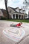 Girl Drawing on a Driveway    Stock Photo - Premium Rights-Managed, Artist: Mark Peter Drolet, Code: 700-02670939