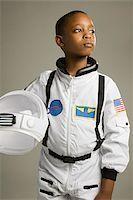 Boy in astronaut costume Stock Photo - Premium Royalty-Freenull, Code: 614-02680967