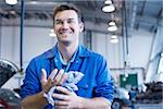Technician working in auto shop Stock Photo - Premium Royalty-Free, Artist: David Mendelsohn, Code: 635-02681377