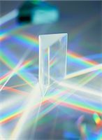 refraction - Refraction. White light being refracted as it passes through a triangular prism to produce a spectrum (rainbow). Refraction is the change of direction of a wave when it passes from one medium to another at an angle. Different colours of light have different wavelengths. The white light is split into a spectrum because the amount of refraction varies with the wavelength. Stock Photo - Premium Royalty-Freenull, Code: 679-02681945