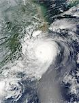 Typhoon Saomai. Satellite image of typhoon Saomai over Taiwan (bottom centre) and China (upper left) on 10th August 2006. Saomai is the most powerful storm to hit China in 50 years, claiming over 100 lives. Typhoons are huge cyclonic storm systems of high winds blowing around a central eye. They form in areas of relatively calm ocean around the equator. As moist air is forced upwards, a low pressu