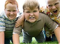 Friendship. Group of boys playing on their hands and knees. Stock Photo - Premium Royalty-Freenull, Code: 679-02682573