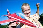 Boy playing with a model aeroplane. Stock Photo - Premium Royalty-Free, Artist: imagebroker, Code: 679-02684074