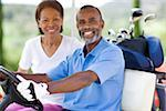 Golf players. Husband and wife using a golf cart during a round of golf. Stock Photo - Premium Royalty-Free, Artist: Uwe Umstätter, Code: 679-02684111
