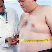 Medical consultation. General practioner measuring the waist of an obese patient. Stock Photo - Premium Royalty-Freenull, Code: 679-02685392
