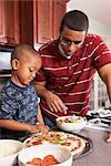 Father and Son in the Kitchen Making a Pizza    Stock Photo - Premium Rights-Managed, Artist: SimplyMui, Code: 700-02686566