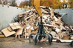 Grapple in front of large heap of scrap wood in recycling center Stock Photo - Premium Royalty-Free, Artist: Dave Robertson, Code: 632-02690390