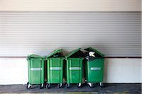 Overflowing garbage cans in a row Stock Photo - Premium Royalty-Freenull, Code: 632-02690393