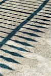 Shadow of wrought iron fence on gravel Stock Photo - Premium Royalty-Free, Artist: Sheltered Images, Code: 633-02691223