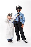 female police officer happy - Girl Dressed as Doctor Checking Boy Dressed as Police Officer Stock Photo - Premium Royalty-Freenull, Code: 600-02693712