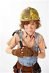 Little Boy Dressed Up as Construction Worker Holding a Hammer Stock Photo - Premium Royalty-Free, Artist: Edward Pond, Code: 600-02693750