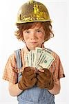 Little Boy Dressed Up as Construction Worker Holding Cash Stock Photo - Premium Royalty-Free, Artist: Edward Pond, Code: 600-02693755