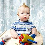 Boy Playing with Toys in High Chair    Stock Photo - Premium Rights-Managed, Artist: Brian Kuhlmann, Code: 700-02693923